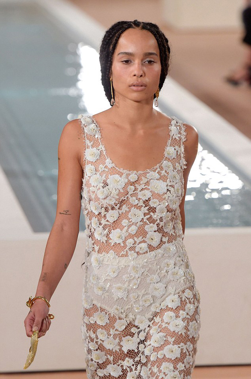 Zoe Kravitz Braless in White Lace Dress on the Catwalk