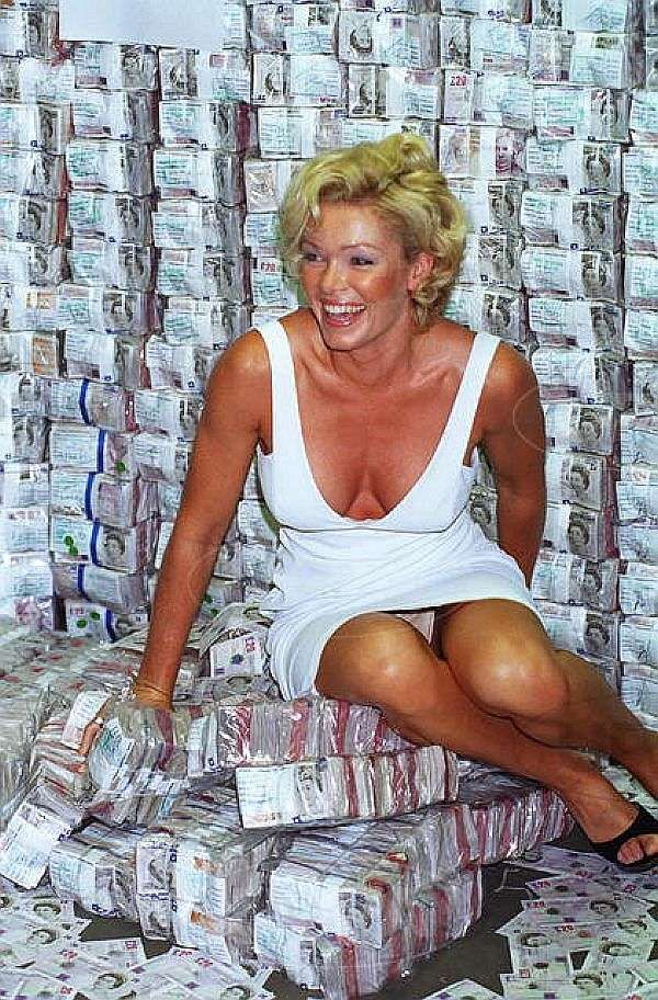 NELL McANDREW Your Upskirt Panty Shot Distracts From The Tons Of Cash You're Sitting On