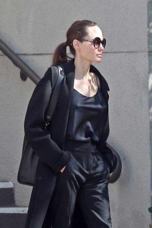 Angelina Jolie Pokies in Silk Shirt