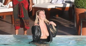 Candice Swanepoel Nip Slip in Leather Jacket in a Pool