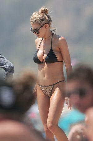 Charlotte McKinney Pokies in her Black Bikini Top