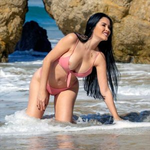 Claudia Alende Nipple Slip on a Photoshoot
