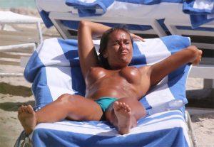 Eda Taspinar Topless Sunbathing