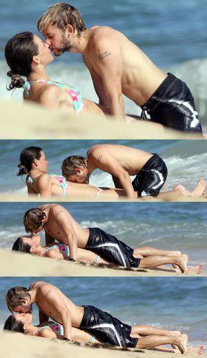 Evangeline Lilly Enjoying A Romp On The Beach