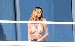 Heidi Klum Caught Topless Sunbathing on the Balcony