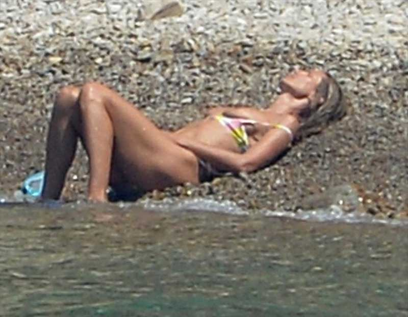 Heidi Klum Topless Sunbathing on an Island