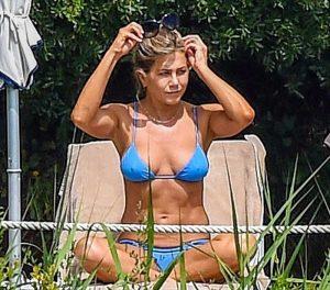 Jennifer Aniston Sunbathing Pokies in Blue Bikini
