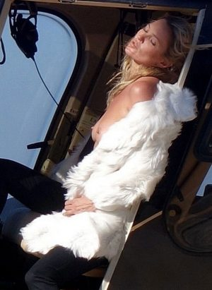 Kate Moss Posing Topless on a Helicopter