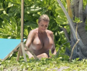 Katie Price Caught Topless on an Empty Beach