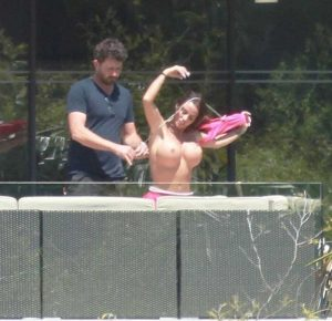 Katie Price Topless Taking off her Pink Bikini Top