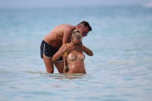 Laura Cremaschi Loses her Bikini Top in the Surf