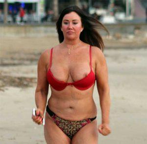 Lisa Appleton Nipple Pops Out on Beach Jog