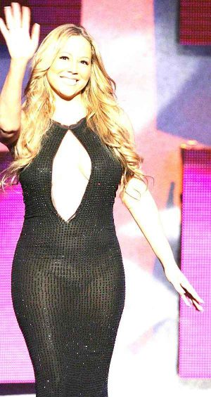 Mariah Carey, Stage Lights, Bright Lights Make For A See Through Peek-A-Boo Black G-String Act.