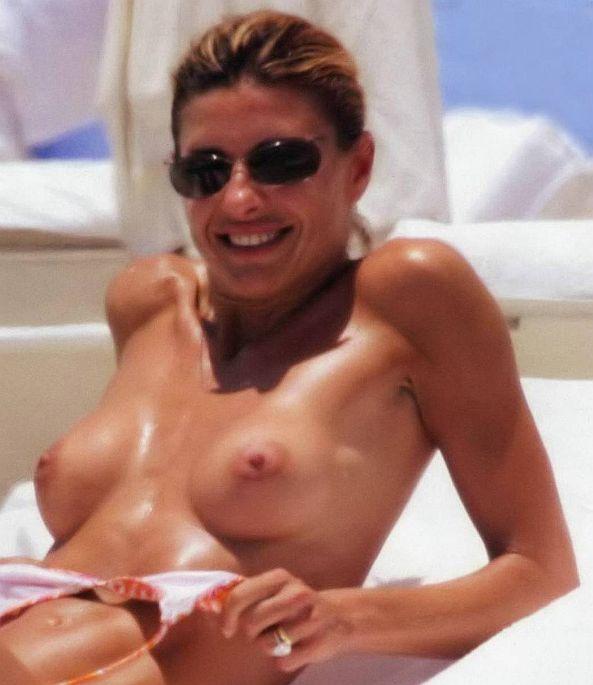 Martina Colombari Topless Sunbathing