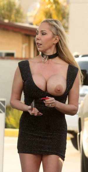 Mary Carey Boob Pops Out Grabbing Gas