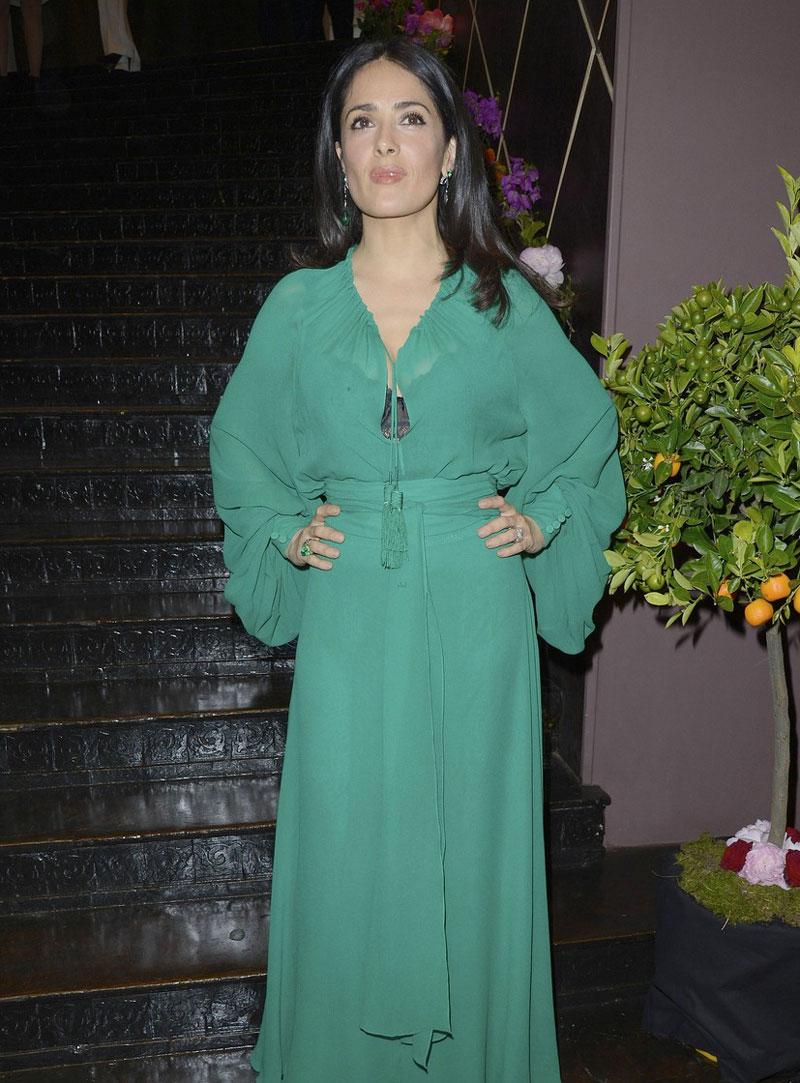 Salma Hayek in a Black Lacey Bra under her See Though Dress