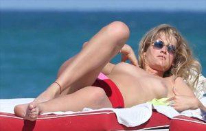 Toni Garrn Topless Sunbathing at the Beach