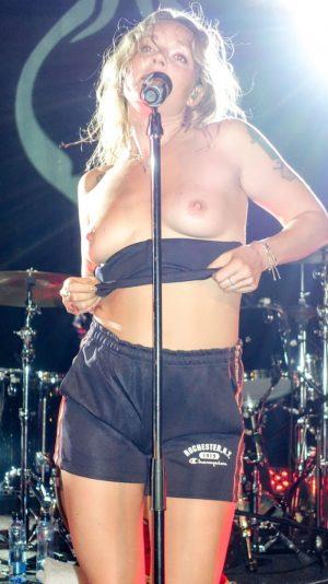 Tove Lo Flashes the Crowd her Bare Breasts
