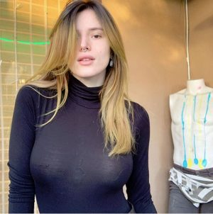 Bella Thorne Braless in See-Through Turtleneck