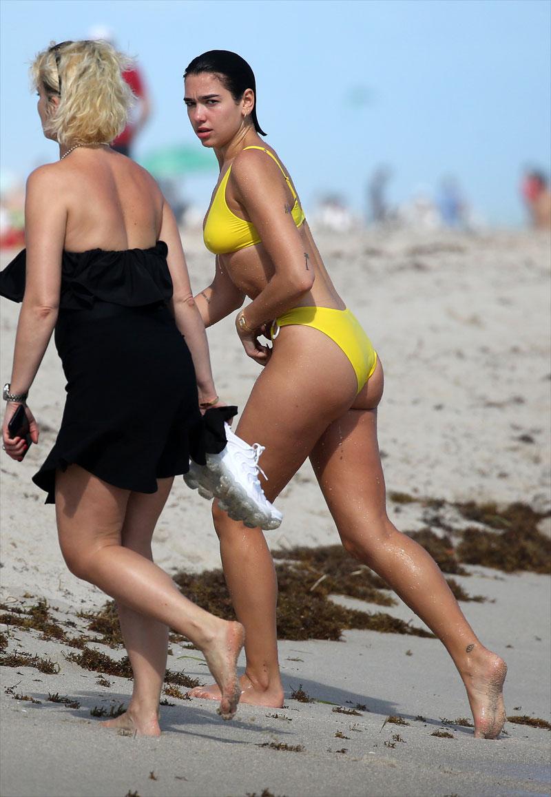 Dua Lipa Nipples in Wet Yellow Bikini