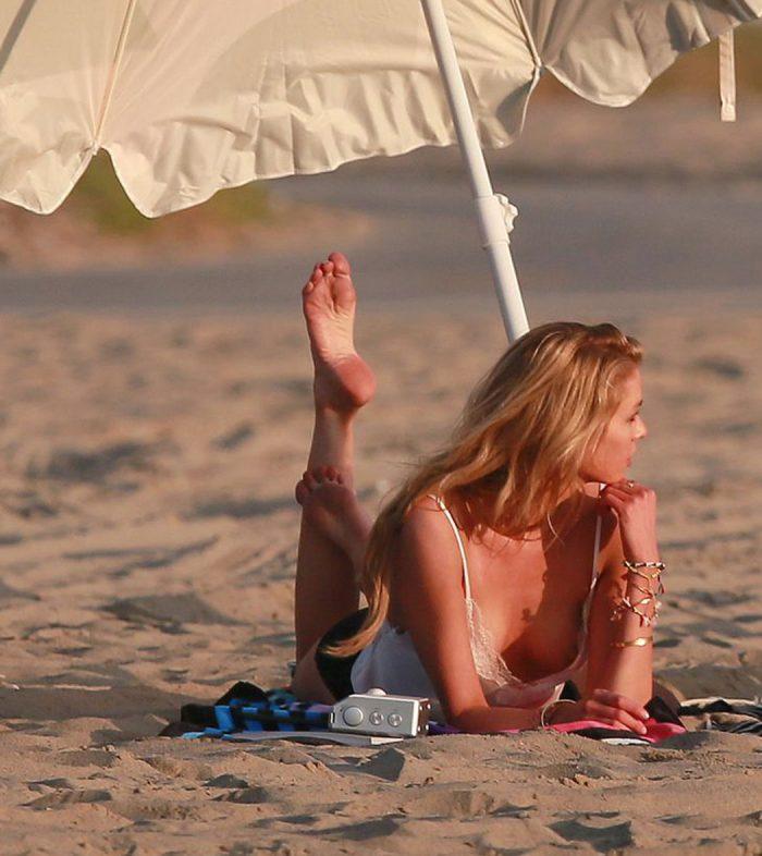 Stella Maxwell Nipple Slip on a Beach Photoshoot