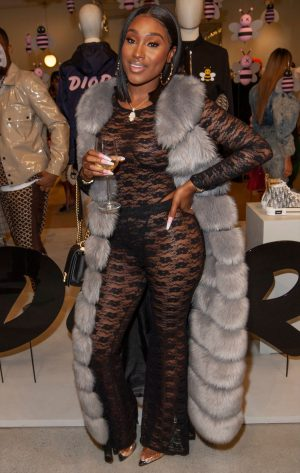 Bernice Burgos Braless in her Black Lace Bodysuit