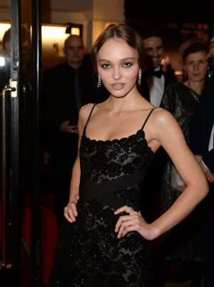 Lily Rose Depp on the Red Carpet Braless in Black Sheer Dress
