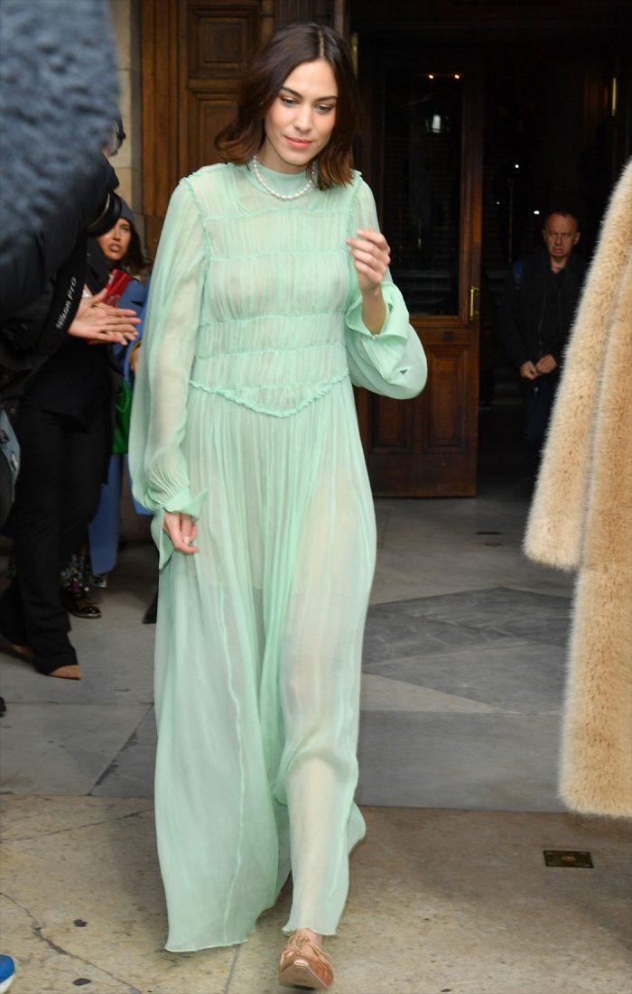 Alexa Chung Braless in Green Dress at Fashion Week