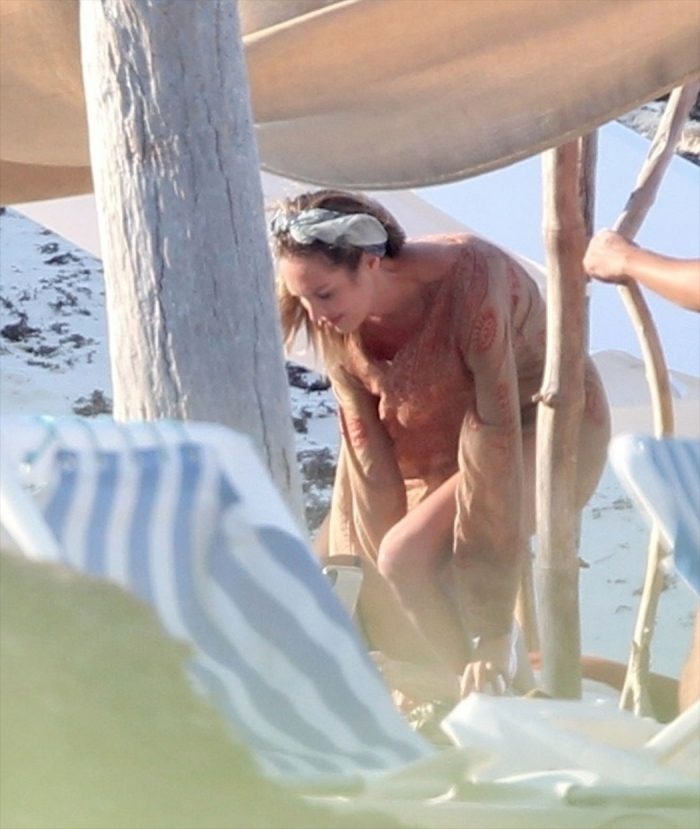 Candice Swanepoel Caught Topless on a Photo Shoot