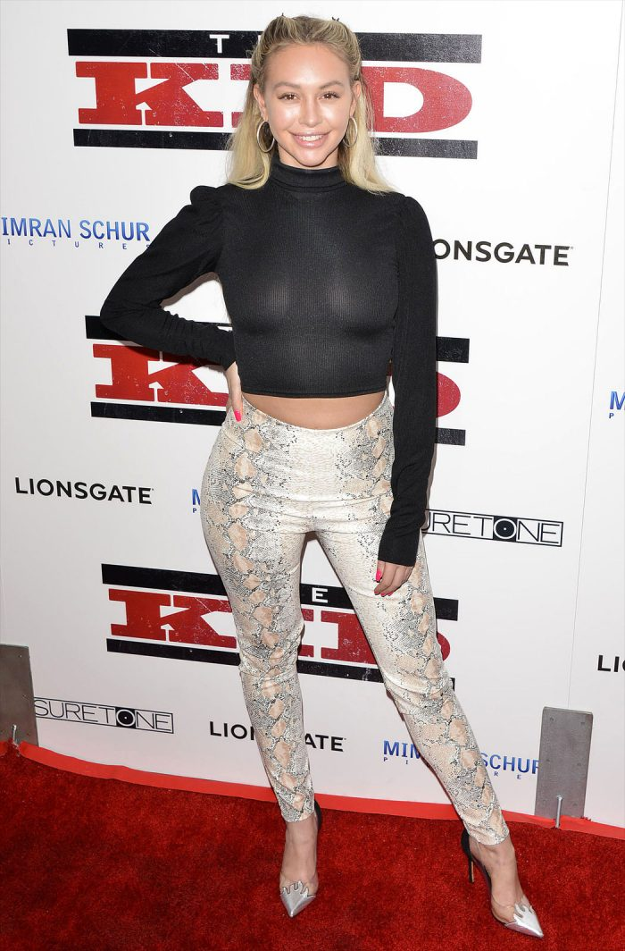 Corinne Olympios in a Slightly See Through Sweater