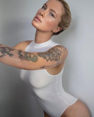 Ireland Baldwin Braless in a Slightly See-Through Body Suit
