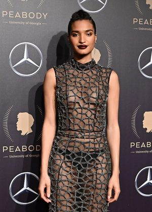 Indya Moore Braless in Black Lace Gown