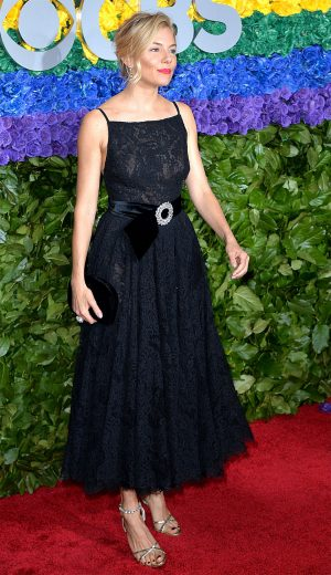 Sienna Miller in Sheer Black Evening Gown