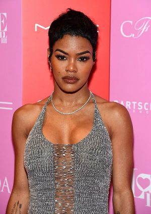 Teyana Taylor Braless in Sheer Silver Gown