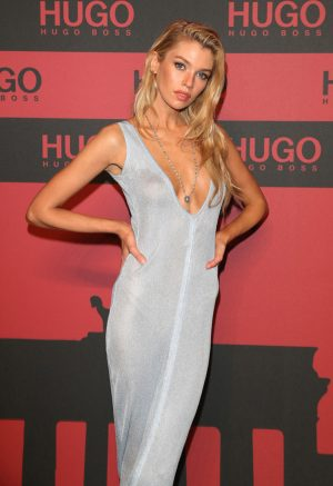 Stella Maxwell Braless in Slightly See Through Gown