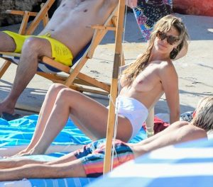 Heidi Klum Topless Sunbathing in White Swimsuit