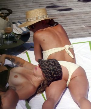 Miley Cyrus Topless Sunbathing in Fendi