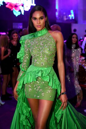 Cindy Bruna Braless in Green Dress at a Fashion Show