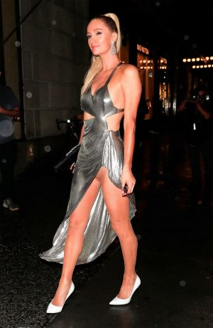 Paris Hilton Upskirt in Shiny Silver Dress