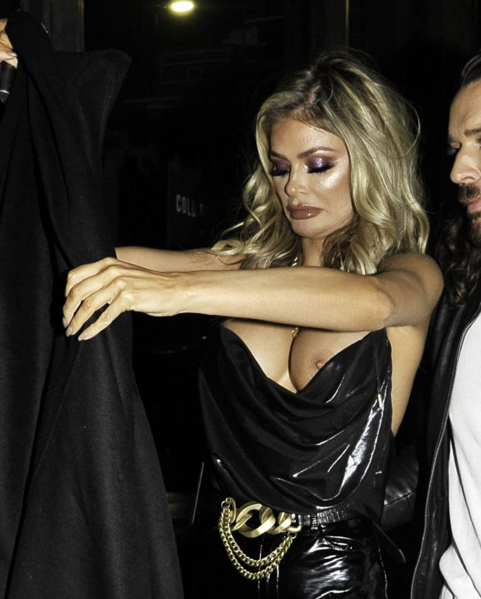 Chloe Sims has one of her Boobs Pop Out of her Silk Top