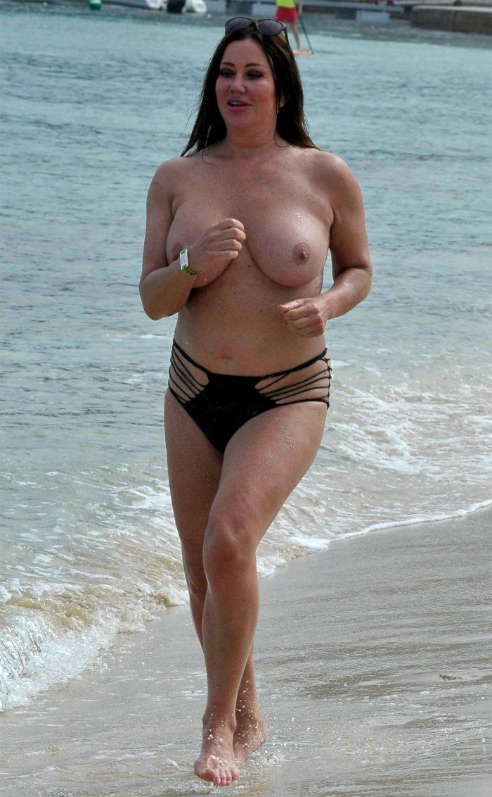Lisa Appleton Jogging Topless on a Beach