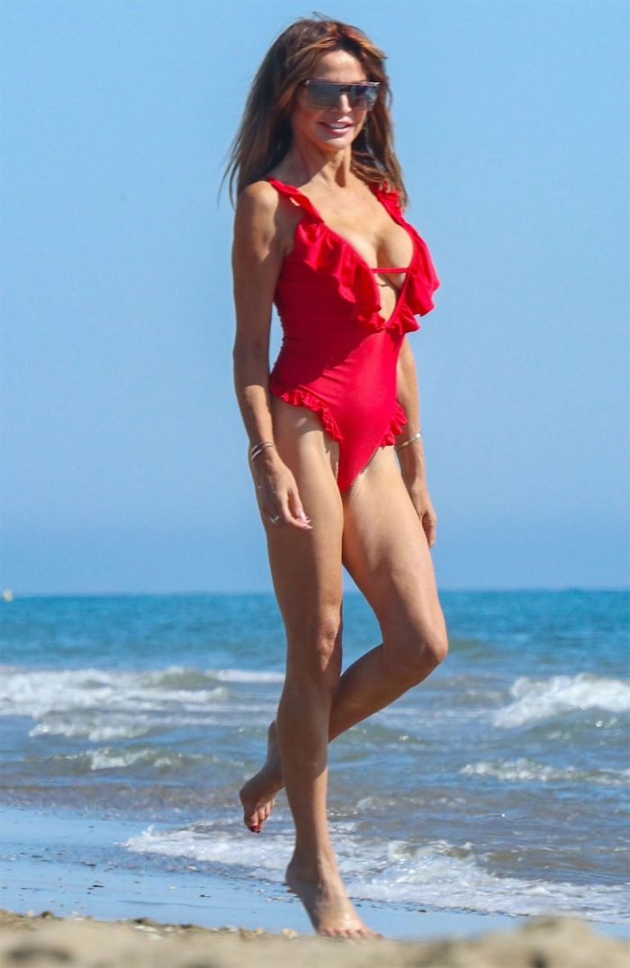 Lizzie Cundy's Pussy Tries to Escape her Red Swimsuit