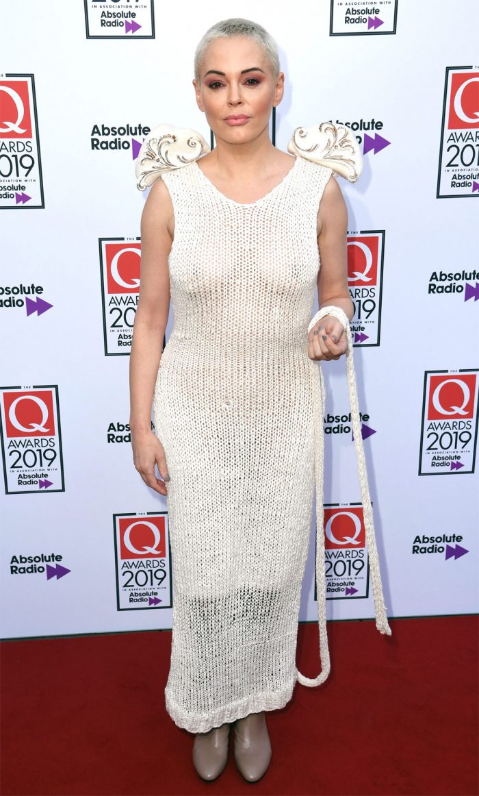 Rose McGown Naked in a Knitted Cream Dress