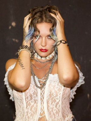 Tove Lo Posing Braless in White Lace Corset