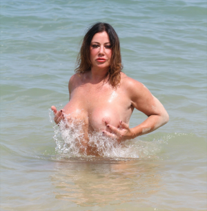 Lisa Appleton Frolicking Topless at the Beach