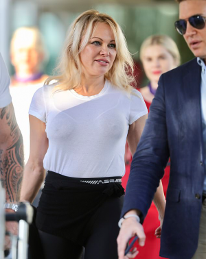 Pamela Anderson in a Sheer White Tee and Sheer White Bra