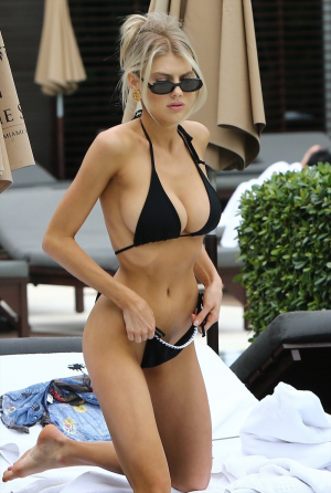 Charlotte McKinney Fills Out her Black Bikini Perfectly