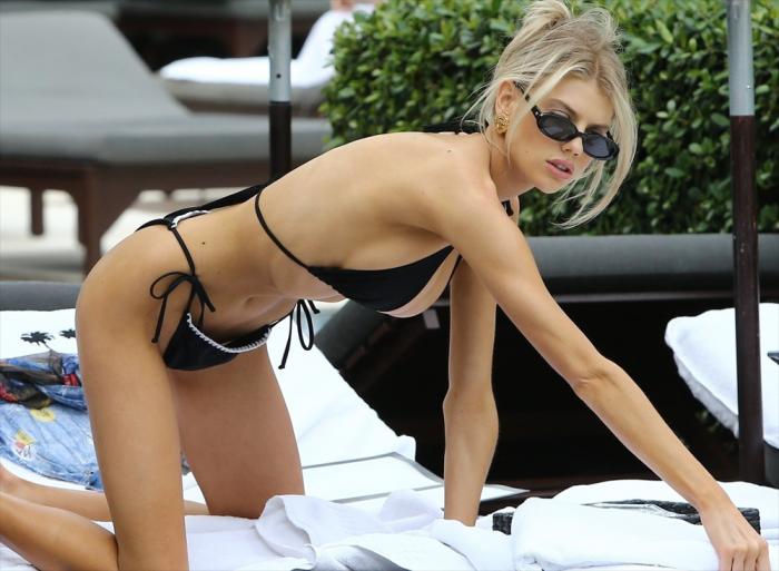 Charlotte McKinney Fills Out her Black Bikini Perfectly
