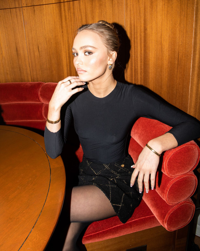 Lily Rose Depp Posing in a Skin Tight Black Top Without her Bra