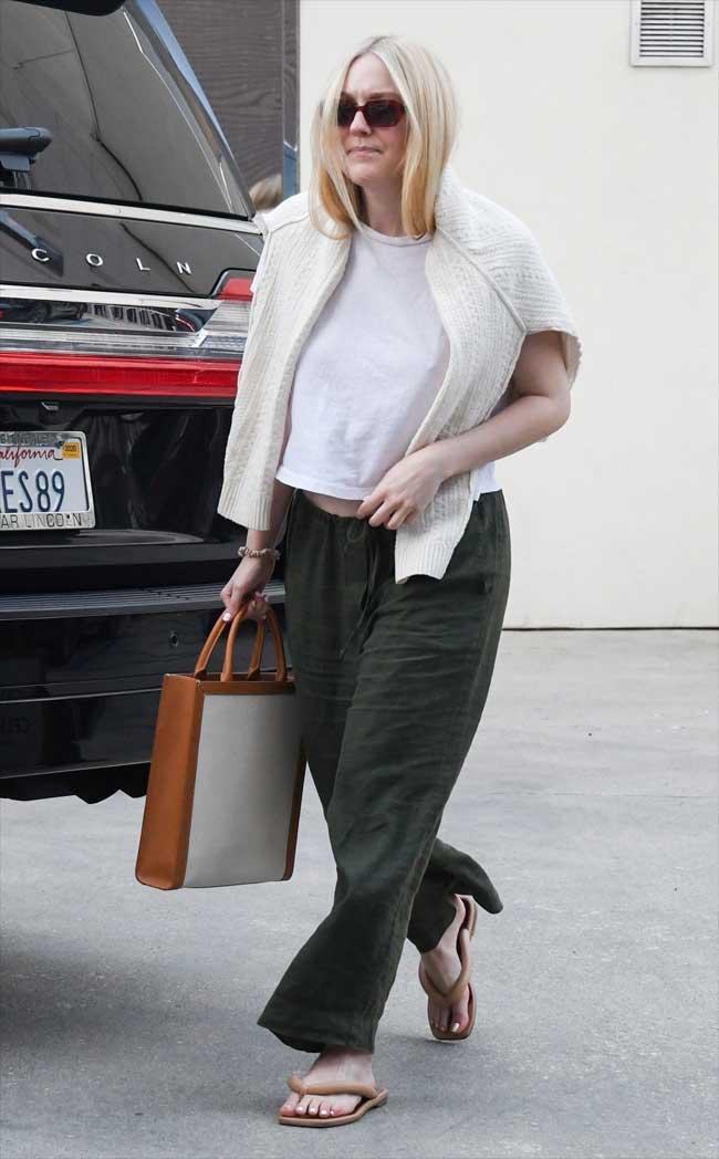 Dakota Fanning Braless Nipple Pokies in White T-Shirt